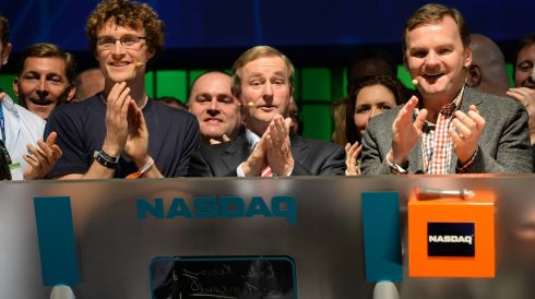 An Taoiseach Enda Kenny rings the NASDAQ Bell to start the American stock exchange, the first time it has been rung from Ireland, with Executive Vice President NASDAQ OMX, Bruce Aust, and Paddy Cosgrave, founder Dublin Web Summit. Photograph: Dara Mac Donaill / THE IRISH TIMES