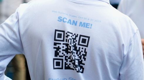 A quick response (QR) code sits on the rear of a delegate's jersey during the Dublin Web Summit. Photograph: Aidan Crawley/Bloomberg