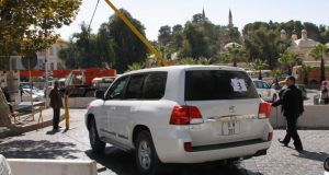United Nations  vehicles transporting a team of experts from the Organisation for the Prohibition of Chemical Weapons, leave their hotel in Damascus last week.  Photograph: Reuters