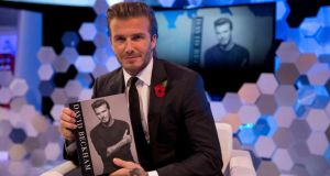 David Beckham at a recent book launch. His son Brooklyn has attracted interest from his former club Manchester United.