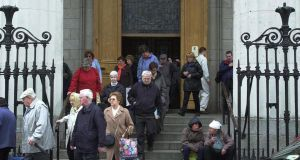 "Massgoers leaving the Pro Cathedral in Dublin. ""The institutional  C church will have to heal the many wounds it has inflicted on so many people in the past,"" Msgr Lane said."