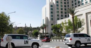 United Nations  vehicles  in  Damascus. It was announced yesterday that Syria had completed the destruction of equipment used to produce chemical weapon Photograph: Khaled al-Hariri /Reuters