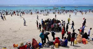 Life in Mogadishu: Lido beach, where couples now stroll hand in hand. Photograph: Omar Faruk/Reuters