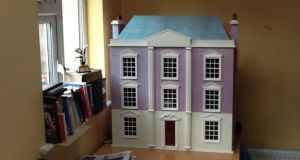 'In the meantime, I had bought a doll's house for my daughter. And this decision, at least, must have been infected by the madness of the period. Because it was an enormous house: a neo-Georgian mansion, with three storeys and an attic, plus basement (for the servants, naturally)'.