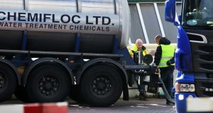 Workers delivering water treatment chemicals to the Ballymore Eustace water treatment plant in Co Wicklow. City engineer Michael Phillips warned that any relaxation in restrictions would leave the capital and surrounding region dry within days. Photograph: Collins