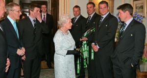 Queen Elizabeth meeting Ronan O'Gara (right) and other members of the Irish Rugby Team at Hillsborough Castle. Photograph: Frank Miller/THE IRISH TIMES