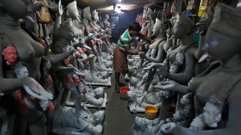 An artist paints an idol of the Hindu goddess Kali at a workshop in Kolkata. Photograph: Rupak De Chowdhuri/Reuters