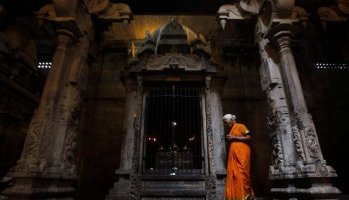 A Tamil devotee prays in Ponnambalavaneshwaram Hindu temple in Colombo. Photograph: Dinuka Liyanawatte/Reuters