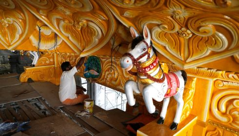 A worker paints a wall inside a Hindu temple for the Diwali festival in Shah Alam, outside Kuala Lumpur. Photograph: Samsul Said/Reuters