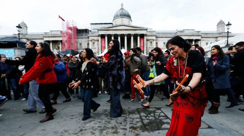 Revellers celebrate Diwali with traditional Garba dancing in Trafalgar Square, central London. Photograph: Jonathan Brady/PA Wire