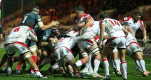 Scarlets push the ball over the line to score against Ulster at Parc y Scarlets. Photograph: Chris Fairweather/Inpho
