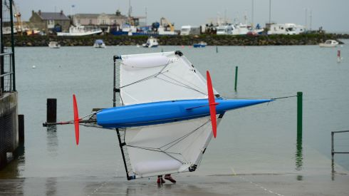 Graeme prepares to launch his lightweight Moth dinghy, constructed from carbon fibre.   Photograph: Frank Miller / The Irish Times