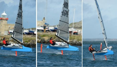 Graeme sails around the harbour with the boat fully foiling. Photograph: Frank Miller / THE IRISH TIMES