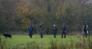 Gardai search a field around the area where the dismembered remains of a man from Blanchardstown were found. Photograph: Dara Mac Dónaill/The Irish Times