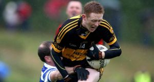 Dr Crokes' Colm Cooper is tackled by  Dan Hegarty of Castlehaven. Photograph: Ryan Byrne/Inpho