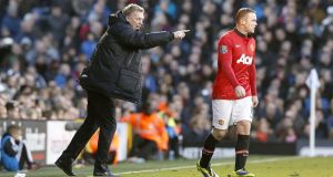 Manchester United manager David Moyes and Wayne Rooney during Saturday's match at Craven Cottage.