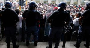 Police stand guard  in central Cape Town last month. Police minister Nathi Mthethwa said the independently compiled figures had vindicated its own statistics released last month. Photograph: Mike Hutchings/Reuters