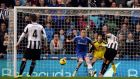 Newcastle United's Loic Remy (R) scores a goal against Chelsea during their English Premier League soccer match at St James' Park