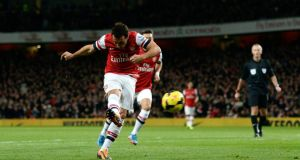 Arsenal's Santi Cazorla scores a goal against Liverpool during their English Premier League soccer match