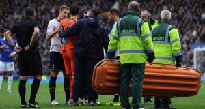 Hugo Lloris receives treatment following the collision. Photograph:  Chris Brunskill/Getty Images
