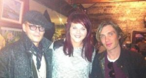 Johnny Depp and Cillian Murphy pictured with fan Amy Dowdall in Weir's pub in Multyfarnham, Co Westmeath, yesterday.