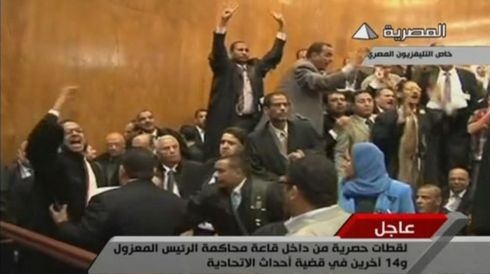 A still image taken from video aired by Egyptian state television shows the crowd shouting during the first day of ousted former Egyptian leader Mohamed Morsi's trial in a courthouse in Cairo today. Mr Morsi's presence sparked chaos in the courtroom, with Morsi's 14 co-defendants chanting against the army who ousted him. Photograph: Egypt State TV via Reuters