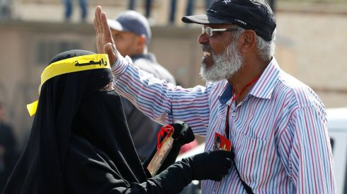 A couple, who are supporters of the Muslim Brotherhood and ousted Egyptian President Mohamed Morsi, take part in a protest outside the police academy, where Mr Morsi's trial started today. Photograph: Amr Abdallah Dalsh/Reuters