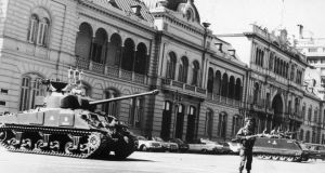 Argentinian soldiers stand guard outside Government House in Buenos Aires, after the military coup in 1976. Photograph: Keystone/Getty Images