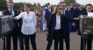 Colleagues of Radio France Internationale journalists Ghislaine Dupont and Claude Verlon pay tribute to their remains at the airport of Bamako during a ceremony yesterday. Photograph: Philippe Desmazes/AFP