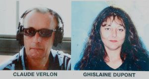 Pictures of French RFI journalists, Ghislaine Dupont, right, and Claude Verlon on a poster headed 'RFI and all France Media World in Mourning' displayed in a window in Paris.