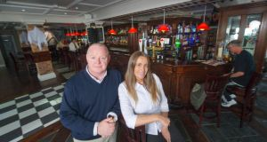 Padraig and Caitriona Hennessy in Clancy's Bar, Youghal. Photographs:  Michael Mac Sweeney/Provision