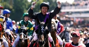 Jockey Damien Oliver, celebrates on race favourite Fiorente celebrates after winning the Melbourne Cup at Flemington. Photograph: Brandon Malone/Reuters.