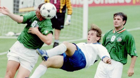 Getting stuck in: Italy's Signori Giuseppe flys for a reverse kick as Roy Keane (left) trys to head the ball away,as Ray Houghton looks on during first half action at Giants stadium in East Rutherford New Jersey June 18th 1994.  Ireland caused an upset beating Italy 1-0.   Photograph: Ray Stubblebine/Reuters