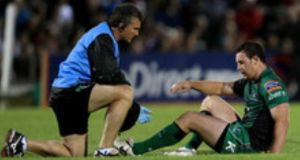 Connacht physio Gavin Malouf attends to Willie Faloon. Photograph: James Crombie/Inpho