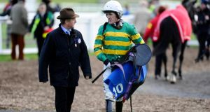 Jonjo O'Neill walks with Tony McCoy at Exeter racecourse. Photograph:   Alan Crowhurst/Getty Images