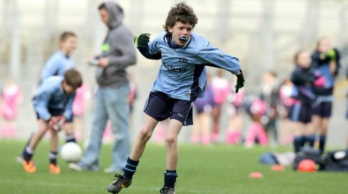 Naoise Mac Conghail of Scoil Lorcain celebrates scoring in Croke Park today. Photograph: Morgan Treacy/INPHO