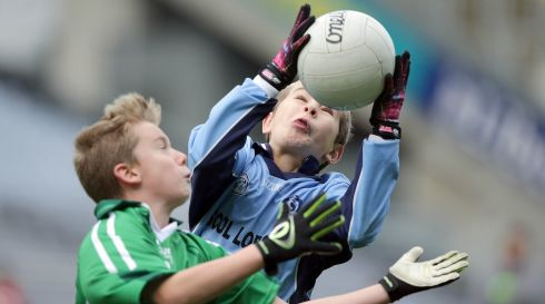 Ciaran De Bruin of Scoil Lorcain with Ben Hanley of Clonburris NS in Croke Park today. Photograph:  Morgan Treacy/INPHO