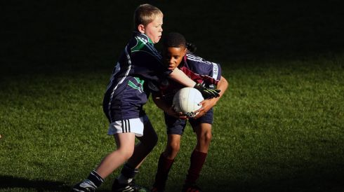 James O'Finn from Gaelscoil Eiscir Riada, Lucan, tackles Richmond Uzoma from St. John the Evangelist NS, Adamstown in Croke Park. Photograph:  Cathal Noonan/INPHO