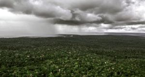 An aerial view of rain approaching in the Brazilian Amazon rainforest