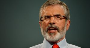 Did Gerry Adams see the icy-expressions on the faces around him as he spoke? Photograph: Alan Betson