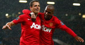 Manchester United's Javier Hernandez celebrates his goal against Norwich City with Ashley Young (R). Photograph: Darren Staples/Reuters.