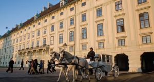 A horse-drawn carriage at the Imperial Palace in Vienna. Photograph: Scott Barbour/Getty Images