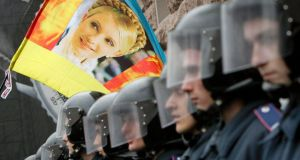 Riot police block opposition supporters carrying a flag with the portrait of jailed former prime minister Yulia Tymoshenko from entering the city hall during a rally in Kiev on October 23rd. Photograph: Gleb Garanich/Reuters