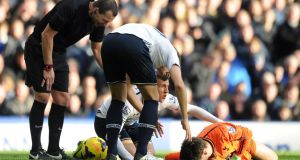 Hugo Lloris lies injured after a collison with Romelu Lukaku.