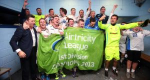 Roddy Collins and the Athlone team celebrate  after winning the league. Photograph: Donall Farmer/Inpho.