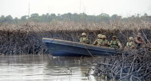The Nigerian military have intensified security in the oil rich Niger Delta to stop vandalisation of oil pipelines by militants. Photograph: AFP
