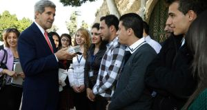 US secretary of state John Kerry meets young Palestinians who presented him with a gift box at Manger Square in Bethlehem yesterday. Photograph: Jason Reed/Reuters