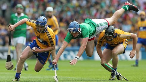 2013 GAA/GPA Hurling All-Star No 13: Pádraic Collins of Clare avoids the attentions of Limerick's Gavin O'Mahony who is upended by Clare's Colin Ryan. Photograph: Lorraine O'Sullivan/Inpho