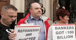 "David Hall (second left) protesting against the auction of ""distressed"" property in 2011. His Irish Mortgage Holders Organisation is involved in an initiative with AIB. photograph: alan betson"