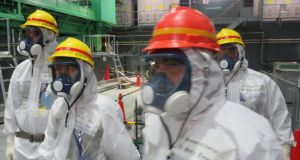 Engineers at the Fukushima nuclear plant  must remove thousands of highly radioactive spent fuel rods one by one and deal with the risk of fire or the fuel pool boiling dry. Photograph: AP Photo/Tokyo Electric Power Co